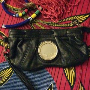 Black Gustto clutch with gold hardware